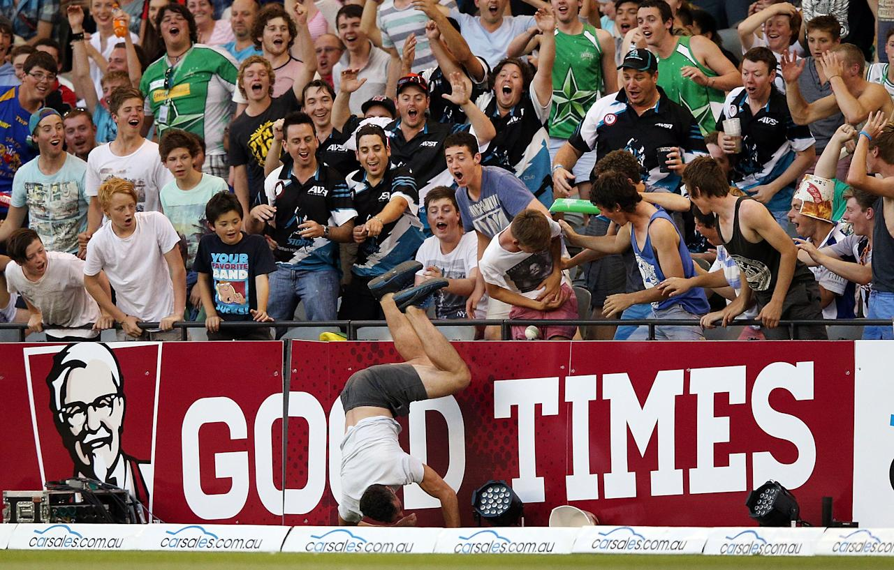 MELBOURNE, AUSTRALIA - DECEMBER 07: Fans try to catch the ball hit for six during the Big Bash League match between the Melbourne Renegades and the Melbourne Stars at Etihad Stadium on December 7, 2012 in Melbourne, Australia.  (Photo by Michael Dodge/Getty Images)