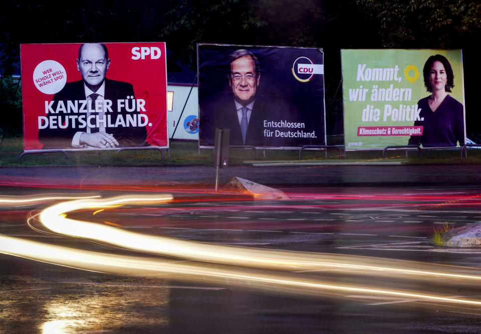 """Three elections posters show Social Democratic top candidate for chancellor Olaf Scholz, left, Christian Democratic top candidate Armin Laschet, center, and top candidate of the Greens Annalena Baerbock in Frankfurt, Germany, Wednesday, Sept. 15, 2021. Letters read """"Chancellor for Germany"""" for Scholz, """"determined for Germany"""" for Scholz and """"come we change politics"""" for Baerbock. Germany prepares for the Sept. 26 election that will determine who succeeds Chancellor Angela Merkel at the helm of Europe's biggest economy. While some of the issues that voters say are most important to them, including climate change and the economy, are global or national in scope, the splintered election campaign has meant many are judging Germany's next leader by focusing on intensely local and personal questions. (AP Photo/Michael Probst)"""