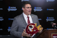 FILE - In this Jan. 2, 2020, file photo, Washington Redskins head coach Ron Rivera holds up a helmet during a news conference at the team's NFL football training facility in Ashburn, Va. The Washington Redskins are undergoing what the team calls a thorough review of the nickname. In a statement released Friday, July 3, 2020, the team says it has been talking to the NFL for weeks about the subject. Owner Dan Snyder says the process will include input from alumni, sponsors, the league, community and members of the organization. FedEx on Thursday called for the team to change its name, and Nike appeared to remove all Redskins gear from its online store. (AP Photo/Alex Brandon, File)