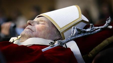 Pall bearers carry the body of the late Pope John Paul II through a packed Saint Peter's ...