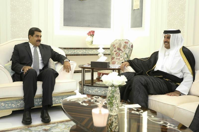 Venezuela's President Nicolas Maduro and the Emir of Qatar, Tamim bin Hamad al-Thani smile during a meeting in this handout picture provided by Miraflores Palace