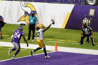 Green Bay Packers wide receiver Davante Adams (17) catches a 1-yard touchdown pass ahead of Minnesota Vikings defensive back Holton Hill (24) during the second half of an NFL football game, Sunday, Sept. 13, 2020, in Minneapolis. (AP Photo/Jim Mone)