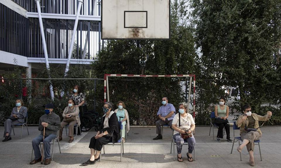 People wait to receive their second dose of the Covid-19 vaccine in Santiago, Chile