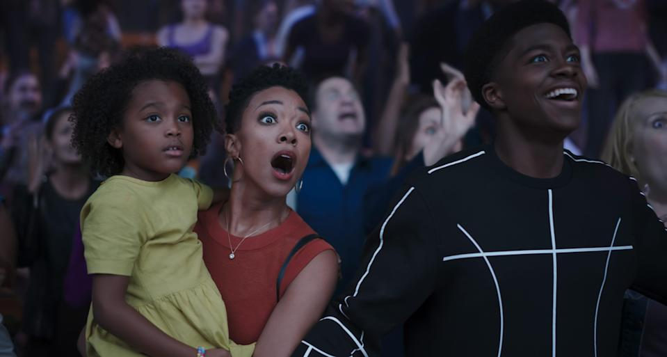 """LeBron James' family also gets pulled into the """"server-verse"""" in """"Space Jam."""" They watch their father play in a high-stakes basketball game. (L-R) Harper Leigh Alexander as Xosha James, Sonequa Martin-Green as Kamiyah James and Ceyair J Wright as Darius James"""