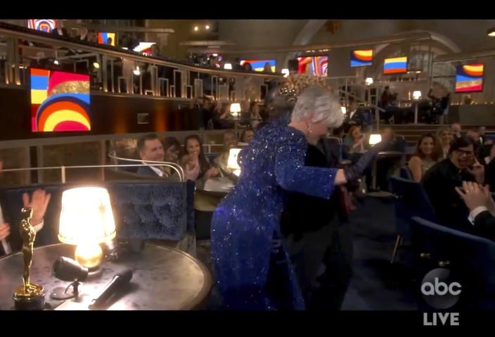"""In this video image provided by ABC, Lil Rel Howery reacts as Glenn Close dances to E.U.'s """"Da Butt"""" in the audience at the Oscars on Sunday, April 25, 2021. (ABC via AP)"""
