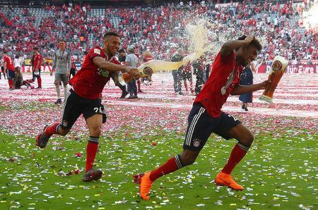 Soccer Football - Bundesliga - Bayern Munich v VfB Stuttgart - Allianz Arena, Munich, Germany - May 12, 2018 Bayern Munich's Corentin Tolisso and Kingsley Coman as they celebrate winning the Bundesliga REUTERS/Michael Dalder