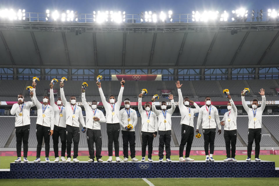 Fiji's players celebrate on the podium with their gold medals in men's rugby sevens at the 2020 Summer Olympics, Wednesday, July 28, 2021 in Tokyo, Japan. (AP Photo/Shuji Kajiyama)