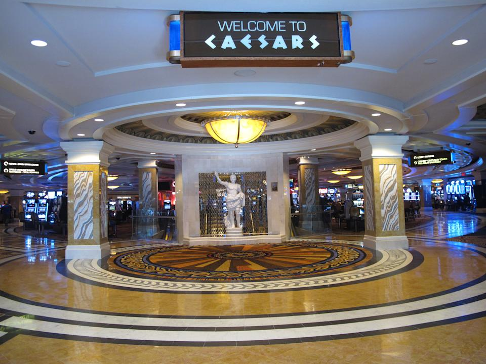 This April 1, 2015 photo shows an entrance to the Caesars casino in Atlantic City, N.J. Figures released Tuesday April 14, 2015 show Caesars experienced a 4.1 decrease in its March casino revenue, to $23.2 million. (AP Photo/Wayne Parry)