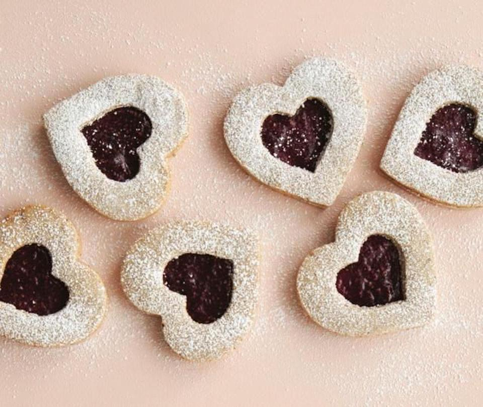 """<p>Similar to a thumbprint cookie, these linzer cookies are baked with raspberry middles but why stop there? Try experimenting with any of your favorite jams or preserves for your own spin on these holiday favorites. <b><a href=""""https://www.yahoo.com/food/linzer-hearts-127739077120.html"""" data-ylk=""""slk:Get the Linzer Hearts recipe;outcm:mb_qualified_link;_E:mb_qualified_link;ct:story;"""" class=""""link rapid-noclick-resp yahoo-link"""">Get the Linzer Hearts recipe</a></b>. <i>(Photo: Charity Burggraaf)</i><br></p>"""