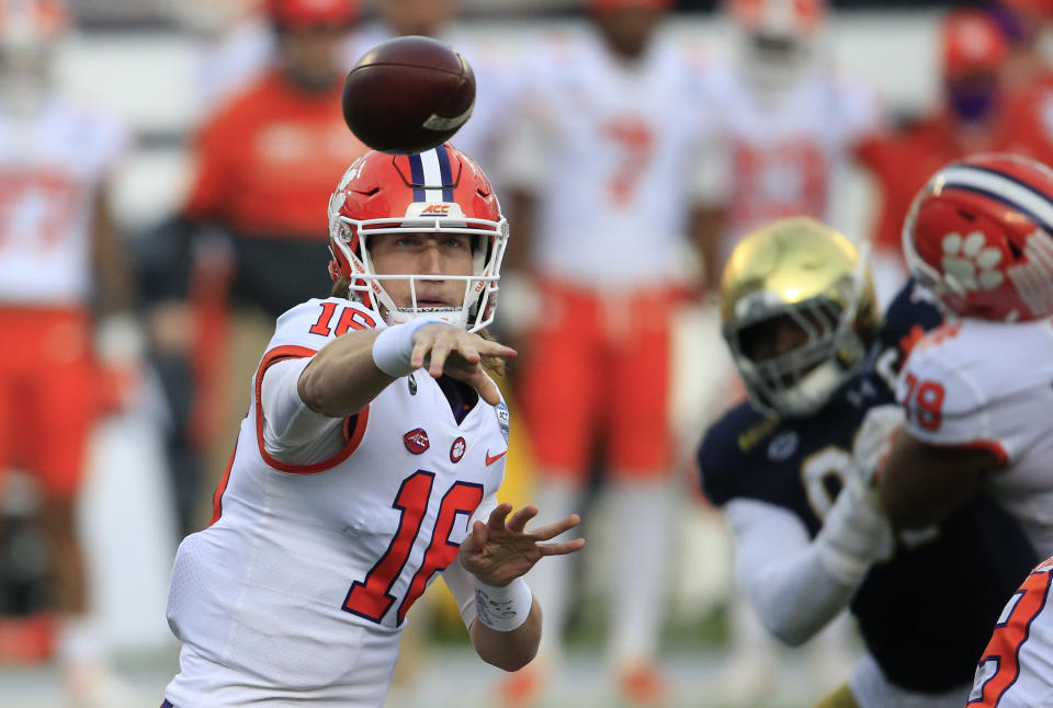 Clemson quarterback Trevor Lawrence (16) will lead his team against Ohio State in one of the two CFP semifinal games on New Year's Day. (AP Photo/Brian Blanco, File)