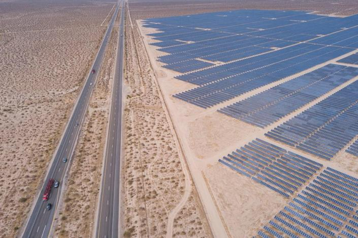 """<div class=""""inline-image__title"""">1233529683</div> <div class=""""inline-image__caption""""><p>Vehicles driving on the California 14 Highway as solar panels, part of an electricity generation plant, stand on June 18, 2021 in Kern County near Mojave, California. The California ISO extended a Flex Alert asking customers to conserve electricity amid concerns of power outages during the heat wave. </p></div> <div class=""""inline-image__credit"""">Patrick T. Fallon/Getty</div>"""