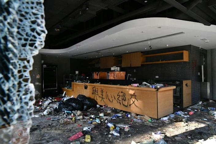 Starbucks, which in Hong Kong is operated by Maxim's, has seen its shops trashed (AFP Photo/Anthony WALLACE)