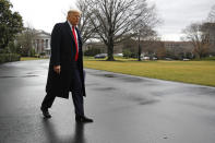 President Donald Trump walks to speak to members of the media on the South Lawn of the White House in Washington, Friday, Feb. 7, 2020, before boarding Marine One for a short trip to Andrews Air Force Base, Md., and then on to Charlotte, N.C. (AP Photo/Patrick Semansky)