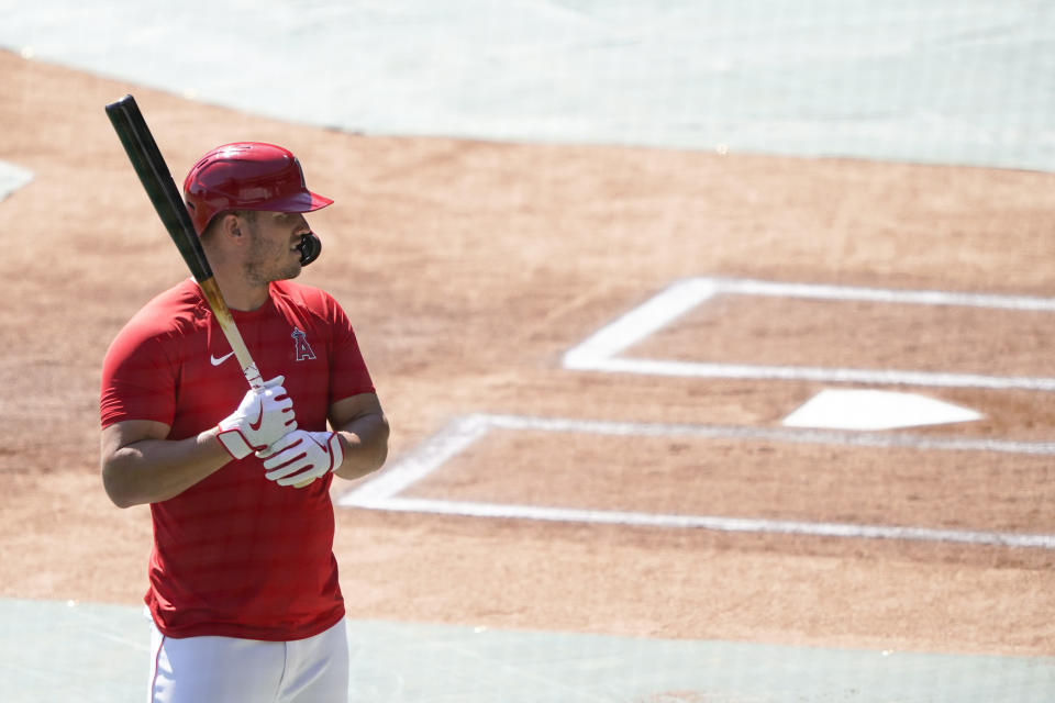 Los Angeles Angels center fielder Mike Trout warms up to bat during baseball practice at Angels Stadium on Saturday, July 4, 2020, in Anaheim, Calif. (AP Photo/Ashley Landis)