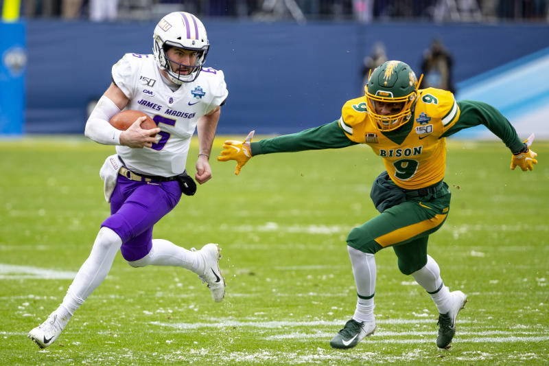 James Madison and quarterback Ben DiNucci (6) lost to North Dakota State in the FCS championship. But little did he know, that game provided a chance meeting with his future NFL coach. (AP Photo/Sam Hodde)