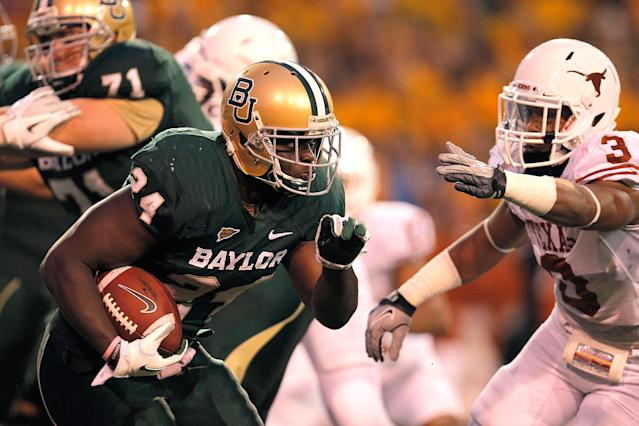 WACO, TX - DECEMBER 03: Terrance Ganaway #24 of the Baylor Bears runs during a game against the Texas Longhorns at Floyd Casey Stadium on December 3, 2011 in Waco, Texas. The Baylor Bears defeated the Texas Longhorns 48-24. (Photo by Sarah Glenn/Getty Images)