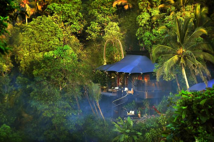 """This camp-style resort designed by Bill Bensley is a tribute to the early European settlers from the 1800s. It nestles between the rainforest, the river, and the paddy fields in a Balinese village called Keliki. Twenty-two tented retreats with sprawling outdoor decks and indoor and outdoor showers are graciously filled with antiques collected and curated by the owner, Suwito Gunawan. <a href=""""http://www.capellaubud.com/"""" rel=""""nofollow noopener"""" target=""""_blank"""" data-ylk=""""slk:capellaubud.com"""" class=""""link rapid-noclick-resp"""">capellaubud.com</a>"""