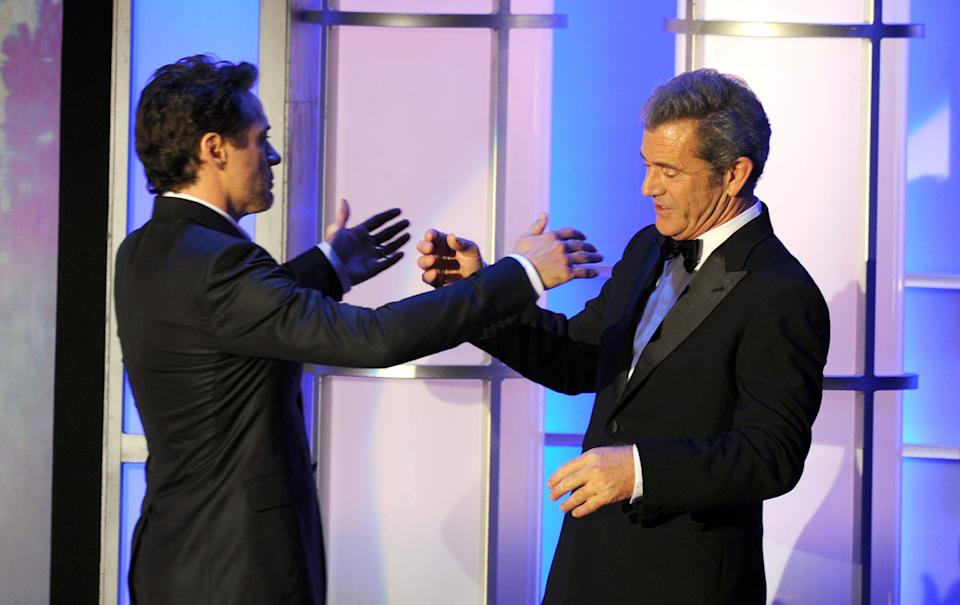 BEVERLY HILLS, CA - OCTOBER 14:  Actor Mel Gibson and honoree Robert Downey Jr. speak onstage during The 25th American Cinematheque Award Honoring Robert Downey Jr. held at The Beverly Hilton hotel on October 14, 2011 in Beverly Hills, California.  (Photo by Kevin Winter/Getty Images)