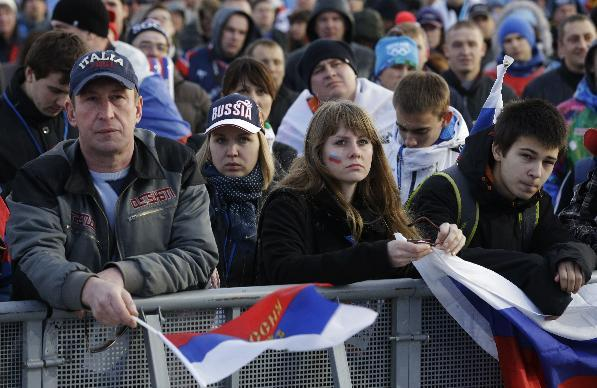 Fans watch the men's ice hockey game between Russia and Finland on a large screen in Olympic Park, at the 2014 Winter Olympics, Wednesday, Feb. 19, 2014, in Sochi, Russia
