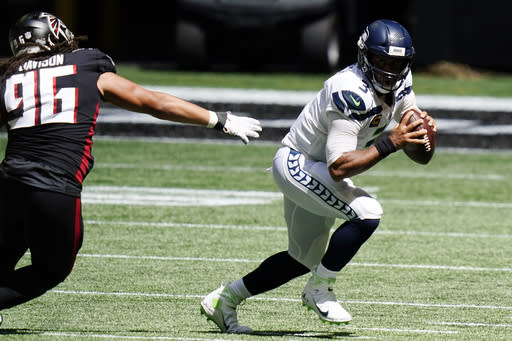 Wilson throws 4 TD passes, Seahawks beat Falcons 38-25