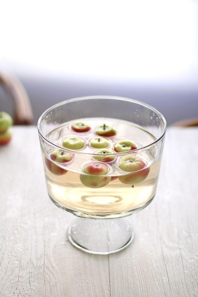"<p>Bobbing for apples is a <em>whole </em>lot more fun when you're dipping your face into a white wine + vodka punch. </p><p><em><a href=""http://www.kellihalldesign.com/apple-bobbing-punch/"" rel=""nofollow noopener"" target=""_blank"" data-ylk=""slk:Get the recipe from Kelli Hall »"" class=""link rapid-noclick-resp"">Get the recipe from Kelli Hall »</a></em></p>"