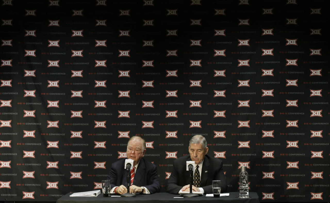 Oklahoma President David Boren, left, and Big 12 Commissioner Bob Bowlsby speak to reporters after The Big 12 Conference meeting in Grapevine, Texas, Monday, Oct. 17, 2016. The Big 12 Conference has decided against expansion from its current 10 schools after three months of analyzing, vetting and interviewing possible new members. (AP Photo/LM Otero)
