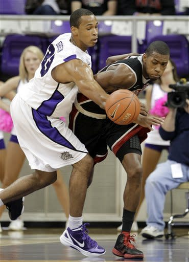 TCU guard J.R. Cadot (23) attempts to stop UNLV 's Mike Moser, right, from reaching a loose ball in the first half of an NCAA college basketball game Tuesday, Feb. 14, 2012, in Fort Worth, Texas. (AP Photo/Tony Gutierrez)