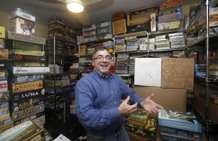 In this Thursday, Jan. 9, 2014, photo, Spirit Airlines CEO Ben Baldanza shows his collection of board games at his home, in Fort Lauderdale, Fla. (AP Photo/Alan Diaz)