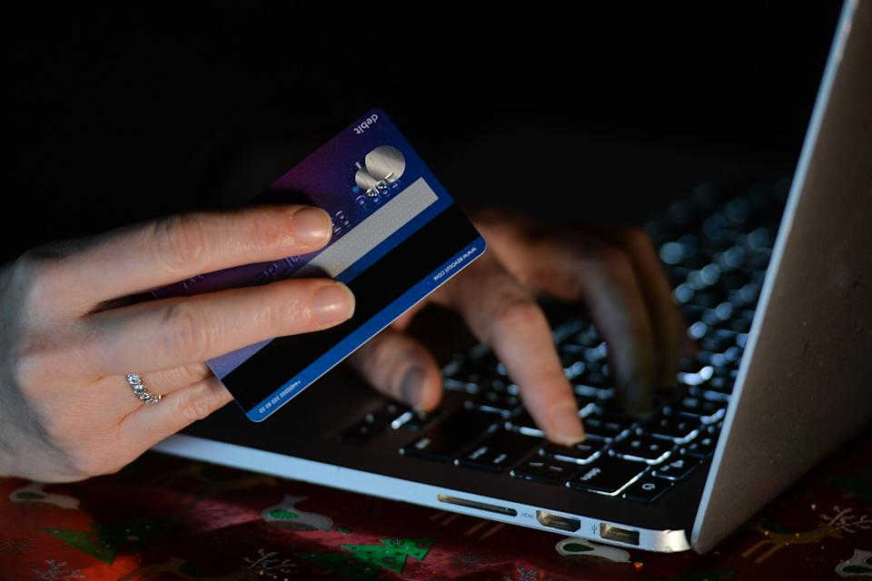 An illustrative image of a person holding a credit card while shopping on-line on a computer. On Sunday, January 3, 2021, in Dublin, Ireland. (Photo by Artur Widak/NurPhoto via Getty Images)