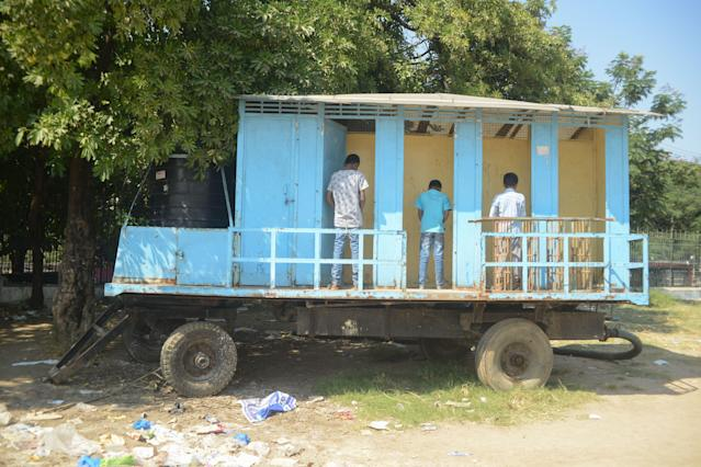 <p>A mobile toilet facility inHyderabad, India. (Photo: Noah Seelam/AFP/Getty Images) </p>
