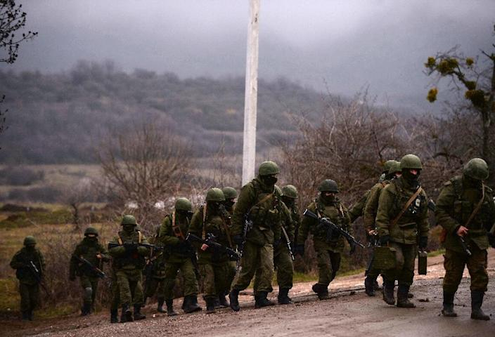 Russian soldiers patrol the area surrounding the Ukrainian military unit in Crimea in 2014; the US backs Ukraine in its struggle to reunite its country after Russia annexed the Crimea region and pro-Russian rebels seized two eastern industrial regions (AFP Photo/FILIPPO MONTEFORTE)