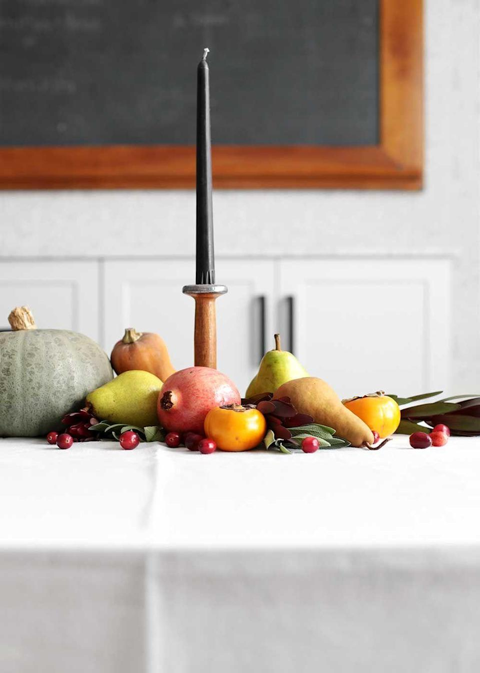 "<p>Proof that you can have your centerpiece ... and eat it, too. Once the festivities wrap up, you can turn the pears, oranges, pumpkins, and pomegranates into post-turkey treats. </p><p><em><a href=""https://www.thefauxmartha.com/2018/11/06/an-edible-thanksgiving-table/"" rel=""nofollow noopener"" target=""_blank"" data-ylk=""slk:Get the tutorial at The Faux Martha »"" class=""link rapid-noclick-resp"">Get the tutorial at The Faux Martha » </a></em></p>"