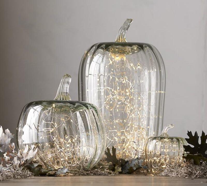"""<p>Gourds are the telltale sign of the season, and these glass renditions coordinate with tableware in any color and style. Fill each cloche with a strand of twinkle lights or a battery-powered candle to get your Thanksgiving table glowing. </p> <p><strong>To buy: </strong>From $11, <a href=""""http://pottery-barn.7eer.net/c/249354/267848/4332?subId1=RS%2CGorgeous%2528Under%252460%2521%2529FallTableDecorationIdeasforThanksgivingandBeyond%2Ckholdefehr1271%2CDEC%2CIMA%2C681776%2C201910%2CI&u=https%3A%2F%2Fwww.potterybarn.com%2Fproducts%2Frecycled-glass-pumpkin-candle-cloche%2F%3F"""" target=""""_blank"""">potterybarn.com</a>. </p>"""