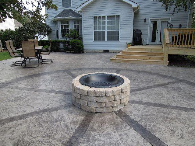 """<p>Because it was built with an insert, which prevents heat from coming in direct contact with the concrete, this simple fire pit can sit on a patio.</p><p><strong>Get the tutorial at <a href=""""https://www.creativelysouthern.com/how-to-build-firepit.html/"""" rel=""""nofollow noopener"""" target=""""_blank"""" data-ylk=""""slk:Creatively Southern"""" class=""""link rapid-noclick-resp"""">Creatively Southern</a>.</strong></p><p><a class=""""link rapid-noclick-resp"""" href=""""https://go.redirectingat.com?id=74968X1596630&url=https%3A%2F%2Fwww.homedepot.com%2Fp%2FPavestone-4-in-x-11-75-in-x-6-75-in-Buff-Concrete-Retaining-Wall-Block-81104%2F100169703&sref=https%3A%2F%2Fwww.countryliving.com%2Fdiy-crafts%2Fg31966151%2Foutdoor-fireplace-ideas%2F"""" rel=""""nofollow noopener"""" target=""""_blank"""" data-ylk=""""slk:SHOP RETAINING WALL BLOCKS"""">SHOP RETAINING WALL BLOCKS</a><strong><br></strong></p>"""