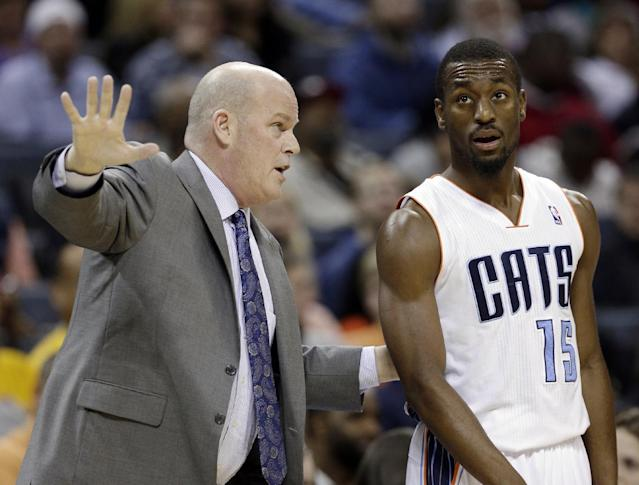 Charlotte Bobcats head coach Steve Clifford, left, talks with Kemba Walker, right, during the first half of an NBA basketball game against the Indiana Pacers in Charlotte, N.C., Wednesday, Nov. 27, 2013. (AP Photo/Chuck Burton)