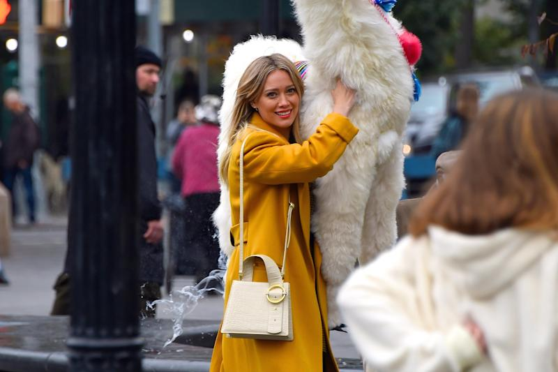 NEW YORK, NY - OCTOBER 29: Hilary Duff seen with a stuffed animal llama at a film set at Washington Square Park on October 29, 2019 in New York City. (Photo by Robert Kamau/GC Images)