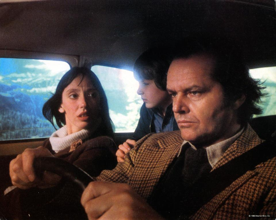 Shelley Duvall, Danny Lloyd, and Jack Nicholson in car on their way to resort in lobby card for the film 'The Shining', 1980. (Photo by Warner Brothers/Getty Images)