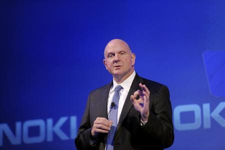 Microsoft CEO Ballmer speaks during a Nokia news conference in Espoo