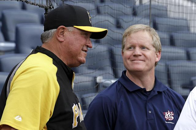 FILE - In this Oct. 5, 2013, file photo, Pittsburgh Pirates manager Clint Hurdle, left, visits with Pirates general manager Neil Huntington during the baseball team's workout in Pittsburgh. The Pirates announced Saturday, April 5, 2014, that they have extended the contracts of both Hurdle and Huntington for three years with a club option for 2018. (AP Photo/Gene J. Puskar, File)