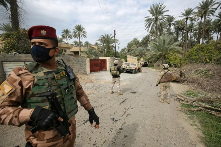 Iraqi forces search the Tarmiyah area, north of Baghdad, on February 20, 2021, following clashes with Islamic State group fighters
