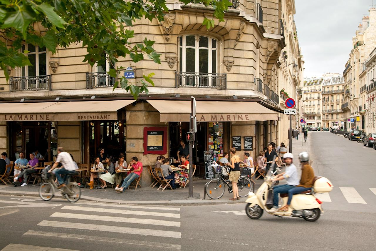 """Parisians relish the arrival of spring's bright, mostly sunny weather as an excuse to enjoy their café society again. Even better for visitors, it's the last month of low prices at hotels like the <a href=""""https://www.cntraveler.com/hotels/france/paris/bel-ami-hotel?mbid=synd_yahoo_rss"""">Bel Ami</a> in artsy Saint-Germain or the Grand Pigalle, a chic spot in the South Pigalle neighborhood. It's too late to register for this year's <a href=""""https://www.verticaletoureiffel.fr/en/race-ecotrail-verticale-de-la-tour-eiffel/la-verticale-de-la-tour-eiffel"""">Verticale de la Tour Eiffel</a>, the marathon-like race where runners compete to see who can summit the 1,665 steps of the tower the fastest on March 11, but you can still watch this year's competitors to gauge whether you fancy trying in 2021. Not the running type? Detour to the <a href=""""https://www.cntraveler.com/activities/paris/centre-pompidou?mbid=synd_yahoo_rss"""">Pompidou Center</a> to catch a major exhibition dedicated to the installation artist duo Christo and the late Jean Claude, and a preview of Christo's upcoming project in September: the Arc de Triomphe wrapped entirely in recycled polypropylene."""