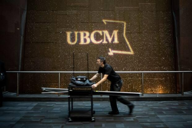 A man pushes a cart at Canada Place during the first day of the UBCM in Vancouver in 2019, the last year the event was held in person.  (Ben Nelms/CBC - image credit)