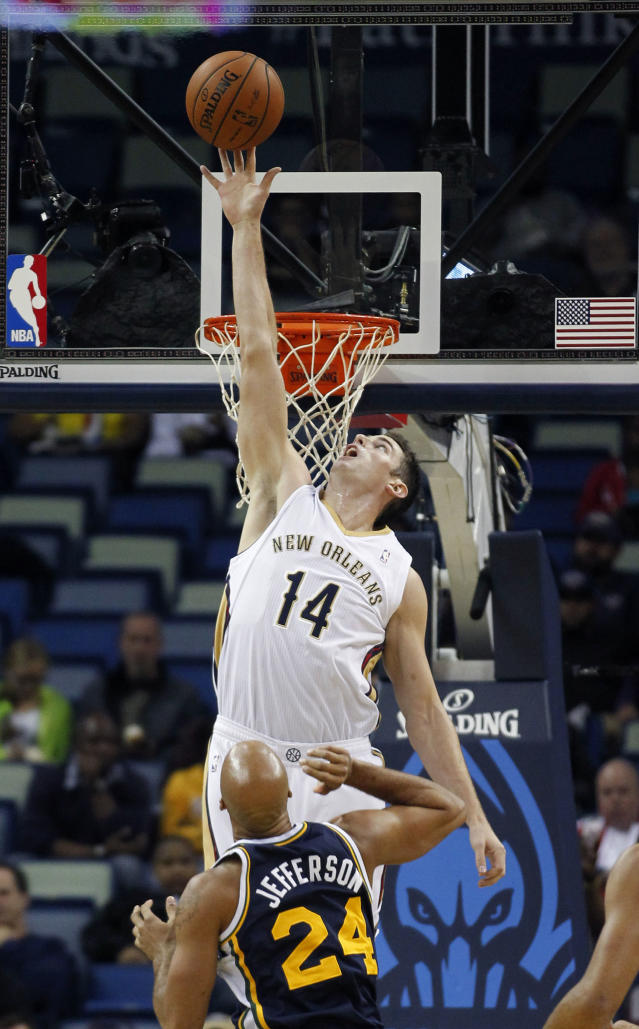 New Orleans Pelicans center Jason Smith (14) leaps to block a shot as Utah Jazz small forward Richard Jefferson (24) looks on in the first half of an NBA basketball game in New Orleans, Wednesday, Nov. 20, 2013. (AP Photo/Gerald Herbert)