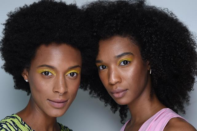 <p>Curly-haired models turn heads with bright yellow eyeshadow. (Photo: NARS) </p>