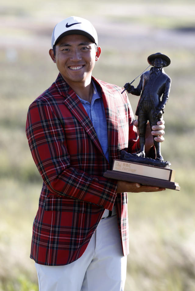 C.T. Pan holds his trophy after winning the RBC Heritage golf tournament at Harbour Town Golf Links on Hilton Head Island, S.C., Sunday, April 21, 2019. Pan won with a 12-under par for his first PGA victory. (AP Photo/Mic Smith)