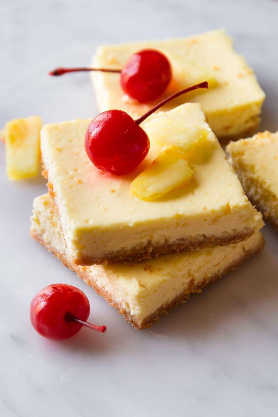 """<p>Transport yourself to the tropics with these lightened-up cheesecake bars.</p><p>Get the <a href=""""https://www.delish.com/uk/cooking/recipes/a34709288/skinny-pineapple-cheesecake-bars-recipe/"""" rel=""""nofollow noopener"""" target=""""_blank"""" data-ylk=""""slk:Skinny Pineapple Cheesecake Bars"""" class=""""link rapid-noclick-resp"""">Skinny Pineapple Cheesecake Bars</a> recipe.</p>"""