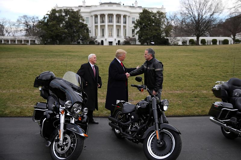 U.S. President Donald Trump shakes hands with Matthew S Levatich, CEO of Harley Davidson, accompanied by Vice President Mike Pence, during a visit of the company's executives at the White House in Washington U.S., February 2, 2017. REUTERS/Carlos Barria (Carlos Barria / Reuters)