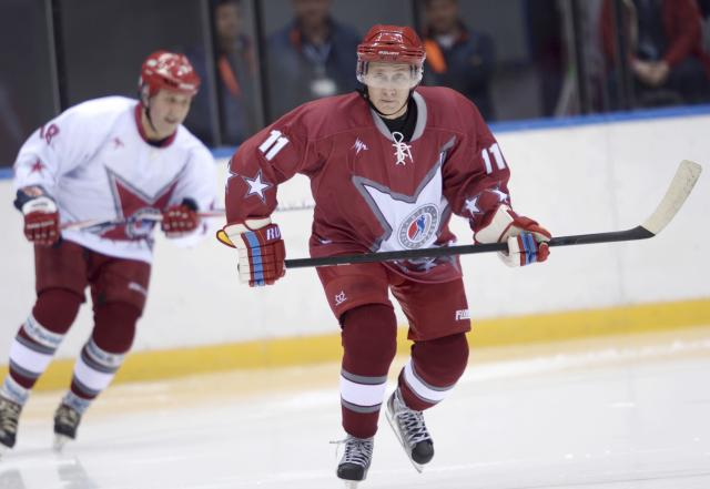 Russian President Vladimir Putin takes part in a friendly ice hockey match in the Bolshoi Ice Palace near Sochi January 4, 2014. REUTERS/Alexei Nikolskiy/RIA Novosti/Kremlin (RUSSIA - Tags: POLITICS SPORT ICE HOCKEY OLYMPICS TPX IMAGES OF THE DAY) ATTENTION EDITORS - THIS IMAGE HAS BEEN SUPPLIED BY A THIRD PARTY. IT IS DISTRIBUTED, EXACTLY AS RECEIVED BY REUTERS, AS A SERVICE TO CLIENTS