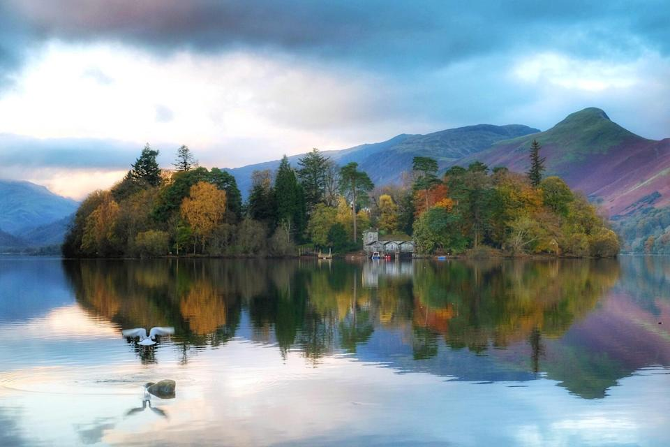 <p>Autumn colours reflected in Derwentwater at Keswick in Cumbria. (AP) </p>