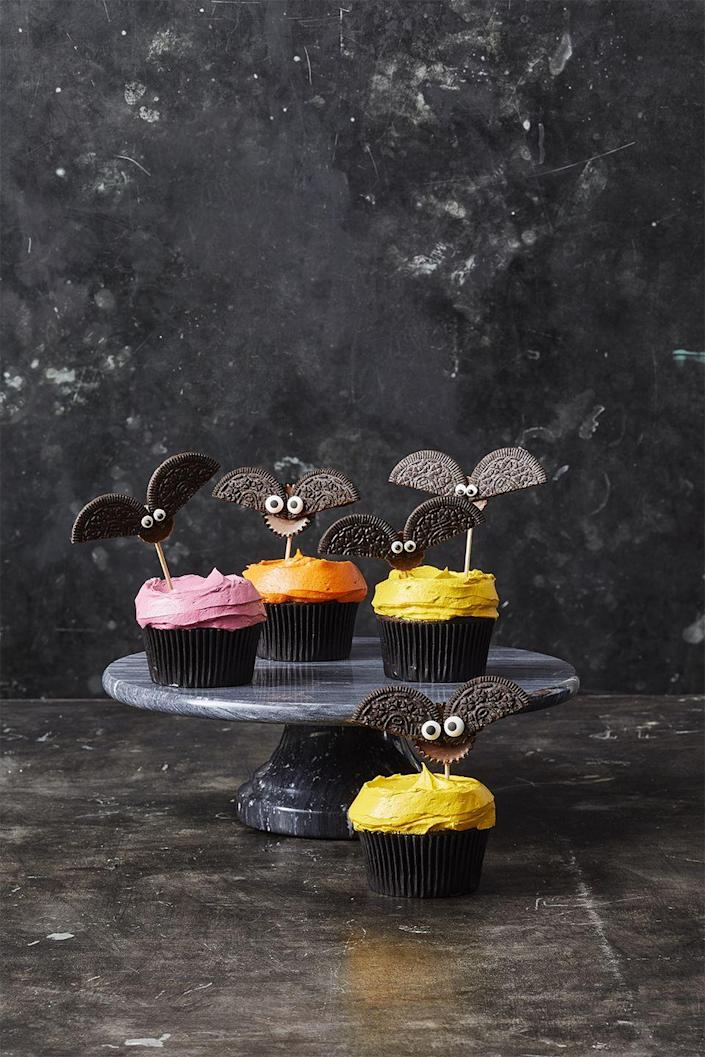 """<p>Perhaps the easiest recipe ever, just make and frost box cupcakes as you normally would (or you can buy them pre-made!), and top with oreo bats that are a cinch to make. </p><p><em><a href=""""https://www.goodhousekeeping.com/food-recipes/party-ideas/a28593120/cookie-bat-cupcakes-recipe/"""" rel=""""nofollow noopener"""" target=""""_blank"""" data-ylk=""""slk:Get the recipe from Good Housekeeping."""" class=""""link rapid-noclick-resp"""">Get the recipe from Good Housekeeping.</a></em></p>"""